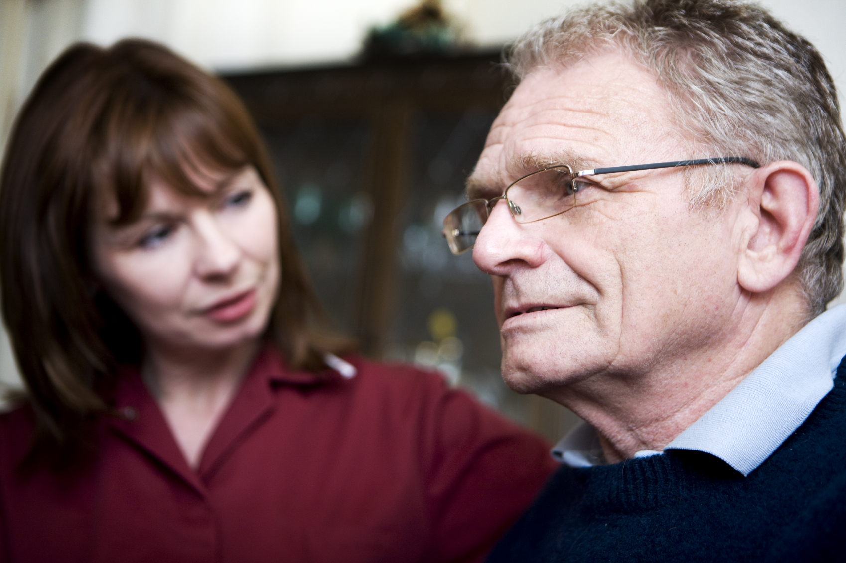 A Social worker talking to a man